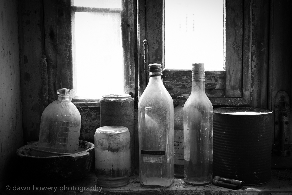 black and white old bottles still life photograph