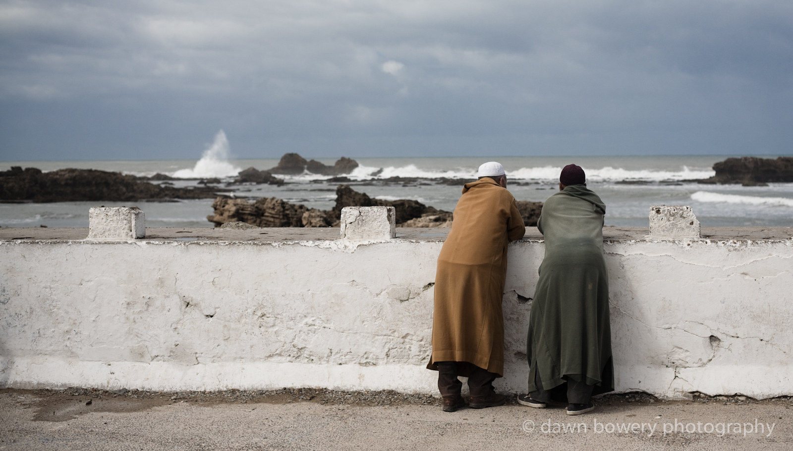 morrocan fine art portrait of two men looking out to sea